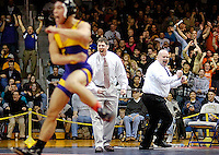 Lake Braddock's George Billy and his coaches Scott Matheny and Ed Foster exult with the crowd after Billy scored a takedown in overtime to win the Virginia AA state 112 lb title over colonial Forge's Shane Gentry by a score of 4-2 at the Virginia AAA state wrestling championships 2-23-08 at Oscar Smith High School in Chesapeake, VA.