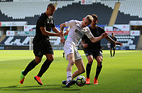 SWANSEA, WALES - MARCH 25:Oli McBurnie of Swansea City  is closely marked by Diogo Verdasca of Porto during the Premier League International Cup Semi Final match between Swansea City and Porto at The Liberty Stadium on March 25, 2017 in Swansea, Wales. (Photo by Athena Pictures)