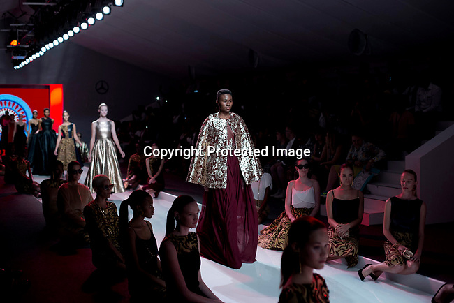JOHANNESBURG, SOUTH AFRICA OCTOBER 29: Models walking for the Mozambican designer label Taibo Bacar on the catwalk during a show at Mercedes Benz Africa fashion week Africa on October 29, 2014 held at Melrose Arch in Johannesburg, South Africa. Designers from all over Africa showed their best collections at the yearly event. (Photo by: Per-Anders Pettersson)