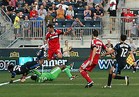 CHESTER, PA - AUGUST 12, 2012:  Sheanon Williams (25) of the Philadelphia Union clashes with  Sean Johnson (25) of the Chicago Fire during an MLS match at PPL Park, in Chester, PA on August 12. Fire won 3-1.