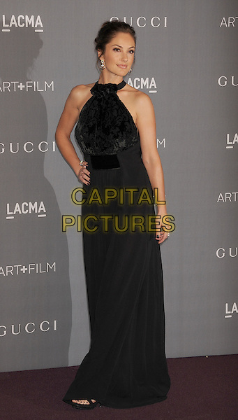 Minka Kelly.at The LACMA 2012 Art and Film Gala held at LACMA in Los Angeles, California, USA..October 27th 2012..full length black high neck hand on hip maxi dress patterned halterneck.CAP/ROT/TM.© TM/Roth/Capital Pictures
