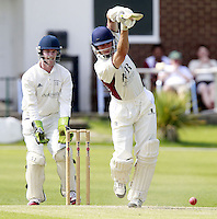 Michael Clements of North Middlesex drives during the ECB Middlesex Premier League game between North Middlesex and Brondesbury at Park Road, Crouch End on Sat June 21, 2014.