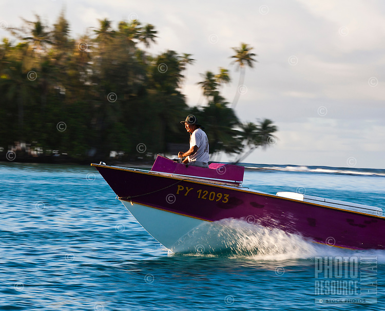 Local poti marara, a fishing speedboat, off Bora Bora, Tahiti