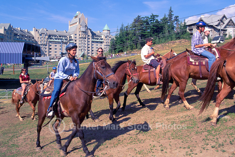 Whistler Blackcomb, BC, British Columbia, Canada - Horseback Riding on Guided Tour, Summer - Fairmont Chateau Whistler in background