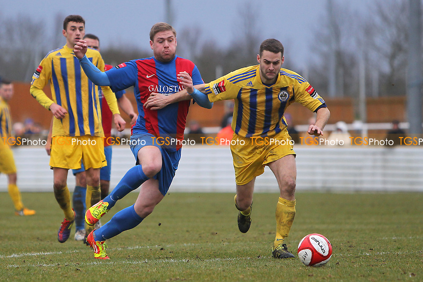 Jamie Guy of Maldon tangles with Paul Clayton of Romford - Maldon & Tiptree vs Romford - Ryman League Division One North Football - 16/03/13 - MANDATORY CREDIT: Gavin Ellis/TGSPHOTO - Self billing applies where appropriate - 0845 094 6026 - contact@tgsphoto.co.uk - NO UNPAID USE.