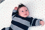 newborn boy 2 months old on back reflex tonic neck fencing  horizontal