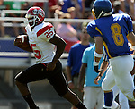MADISON, SD - AUGUST 30: Tyler Beniot #25 of Bacone College streaks down the sideline as Reid Meierkort #8 of Dakota State University takes the angle to cut him off in the second quarter of their game Saturday afternoon at Trojan Field in Madison. (photo by Dave Eggen/Inertia)