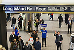 Manhattan, New York, U.S. 4th November 2013. TOM SUOZZI, Democratic candidate for Nassau County Executive, (lower Right) meets potential voters descending the escalators during his campaign stop at Penn Station, near end of 36 straight hours of barnstorming across Nassau County, leading up to the November 5 general election. Former Nassau County Executive Suozzi and incumbent Republican Mangano are once again facing each other as challengers.