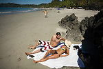 MANUEL ANTONIO, COSTA RICA- JANUARY 10, 2009:  Andres Vicente and Mariangela Navaro, of San Jose, lay in the sun on Espadilla Norte Beach on January 10, 2009 in Manuel Antonio, Costa Rica.    (Photo by Michael Nagle)