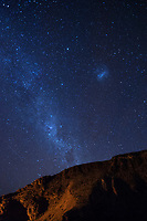 The milky way, bright in the blue sky above the cliffs above Second Valley.
