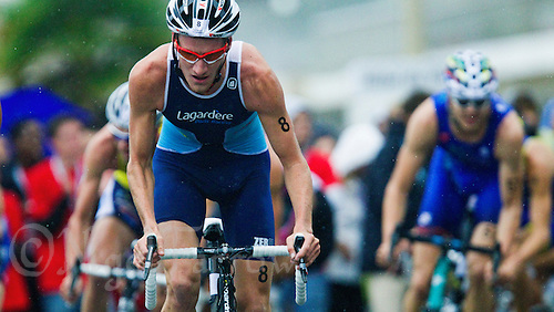 17 SEP 2011 - LA BAULE, FRA - Will Clarke (Lagardere Paris Racing) works on the bike during the final round of the men's French Grand Prix Series at the Triathlon Audencia in La Baule, France .(PHOTO (C) NIGEL FARROW)