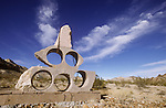 David Spicer's Chained to the Earth which was destroyed in 2009, Goldwell Open Air Museum and Sculpure Park, Rhyolite, Nev.