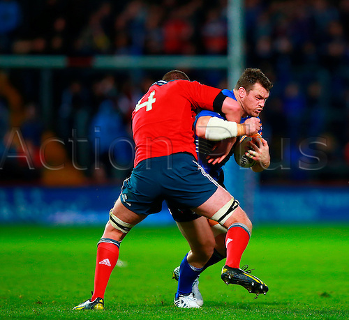 05.10.2013 Limerick, Ireland. Cian Healy (Leinster) tackled by Donnacha Ryan (Munster) during the RaboDirect Pro 12 game between Munster and Leinster from Thomond Park.
