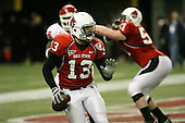 January 5th, 2008:  Ball State quarterback Nate Davis (13) avoids pressure in his own end zone during the second quarter of the International Bowl at the Rogers Centre in Toronto, Ontario Canada...Rutgers defeated Ball State 52-30.  ..Photo By:  Mike Janes Photography