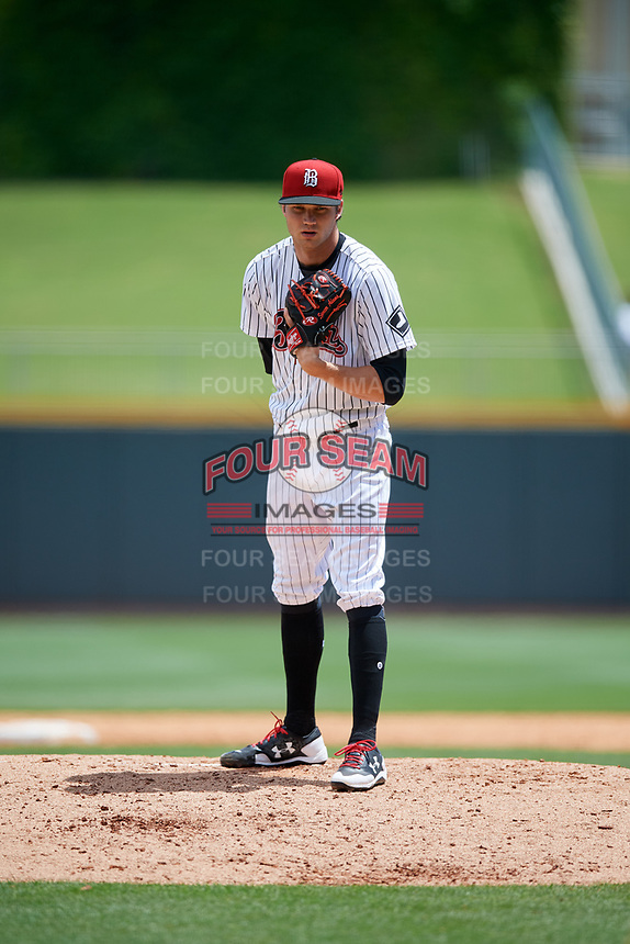 Birmingham Barons starting pitcher Spencer Adams (12) looks in for the sign during a game against the Jacksonville Jumbo Shrimp on April 24, 2017 at Regions Field in Birmingham, Alabama.  Jacksonville defeated Birmingham 4-1.  (Mike Janes/Four Seam Images)