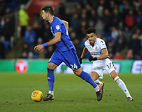 Bolton Wanderers' Derik Osede keeps an eye on Cardiff City's Marko Grujic<br /> <br /> Photographer Kevin Barnes/CameraSport<br /> <br /> The EFL Sky Bet Championship - Cardiff City v Bolton Wanderers - Tuesday 13th February 2018 - Cardiff City Stadium - Cardiff<br /> <br /> World Copyright &copy; 2018 CameraSport. All rights reserved. 43 Linden Ave. Countesthorpe. Leicester. England. LE8 5PG - Tel: +44 (0) 116 277 4147 - admin@camerasport.com - www.camerasport.com