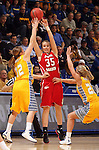 SIOUX FALLS, SD - MARCH 12:  Nicole Seekamp #35 from the University of South Dakota passes out of a double team by Tara Heiser #12 and Chloe Cornemann #22 from South Dakota State University in the second half of the 2013 Women's Summit League Championship Game on Tuesday afternoon at the Sioux Falls Arena. (Photo by Dave Eggen/Inertia)