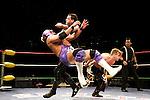 Lucha Libre AAA wrestler Vampiro clotheslines Silver King at a match in Sacramento, CA March 28, 2009.