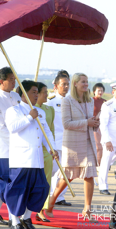 Crown Prince Haakon & Crown Princess Mette-Marit of Norway visit Thailand..Arrival at Don Muang International Airport with HKH Princess Maha Chakri Sirindhorn..
