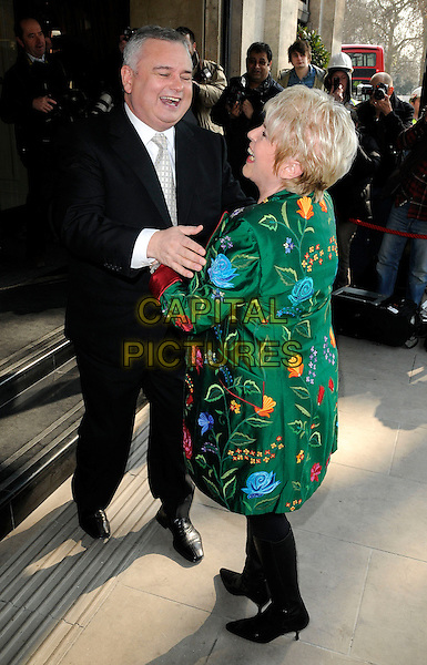 EAMONN HOLMES & GLORIA HUNNIFORD .Attending the TRIC (Television and Radio Industries Club) Awards at the Grosvenor House Hotel, Park Lane, London, England, UK, March 8th 2011..outside arrivals full length black suit green patterned floral jacket smiling funny hugging .CAP/CAN.©Can Nguyen/Capital Pictures.