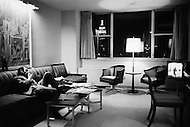 March, 1965, Manhattan, NYC, Americana Hotel, 6th Avenue, Charles Avnavour makes an early call to Paris while relaxing in his room after a long day promoting Taxi For Tobruk, a film he starred in.