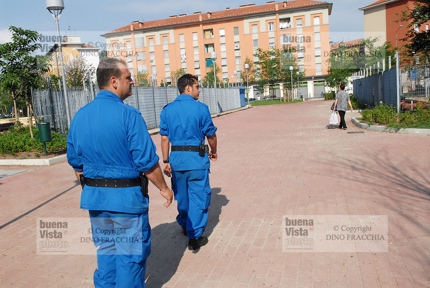 "- volunteers of  ""Blue Berets"" association in security service for Milan Municipality in Selinunte square, district considered at sea for the high presence of immigrants....- volontari dell'associazione ""Blue Berets"" in servizio di sicurezza per il Comune di Milano in  piazza Selinunte, quartiere considerato a rischio per l' alta presenza di immigrati"