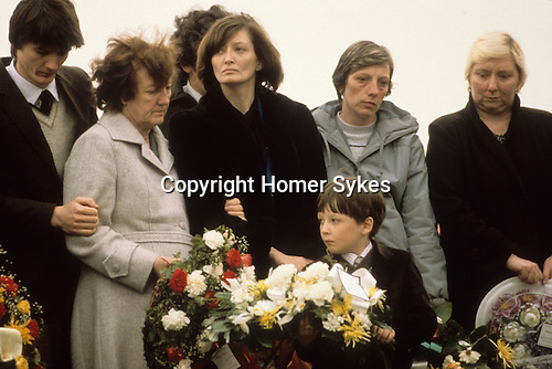 """Bobby Sands """"Robert Gerard Sands"""" funeral with mother in pale coat. Wife Geraldine Noade ( centre) and son Gerard 1981 Milltown cemetery Northern Ireland UK"""