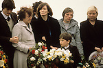 "Bobby Sands ""Robert Gerard Sands"" funeral with mother in pale coat. Wife Geraldine Noade ( centre) and son Gerard 1981 Milltown cemetery Northern Ireland UK"