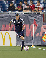 New England Revolution midfielder Chris Tierney (8) controls the ball. In a Major League Soccer (MLS) match, the Seattle Sounders FC defeated the New England Revolution, 2-1, at Gillette Stadium on October 1, 2011.