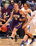 SIOUX FALLS, SD - MARCH 10:  Michelle Maher #14 from Western Illinois drives against Rachel Mauk #2 from IPFW in the second half of their quarterfinal game Sunday afternoon at the 2013 Summit League Championships in Sioux Falls, SD.  (Photo by Dave Eggen/Inertia)