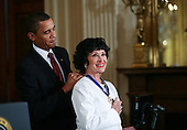 Washington, DC - August 12, 2009 -- United States President Barack Obama (L) presents Hispanic actress, singer and dancer Chita Rivera the 2009 Medal of Freedom.  The award is the highest honor a civilian can achieve for being recognized for their outstanding achievements in life. The award were given to Stephen Hawking, Ted Kennedy, Billie Jean King, Harvey Milk (posthumously) , Sandra Day O'Connor, Desmond Tutu, Dr. Pedro Jose Greer, Nancy Goodman Brinker, Jack Kemp (posthumously), Reverend Joseph Lowery, Dr. Joseph Medicine Crow, Mary Robinson, Janet Davison Rowley, Dr. Muhammad Yunus, Chita Rivera, and Sidney Poitier. .Credit: Gary Fabiano / Pool via CNP