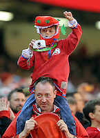 A young boy Wales supporter wears a red dragon outfit cheers on during the RBS 6 Nations Championship rugby game between Wales and Scotland at the Principality Stadium, Cardiff, Wales, UK Saturday 13 February 2016