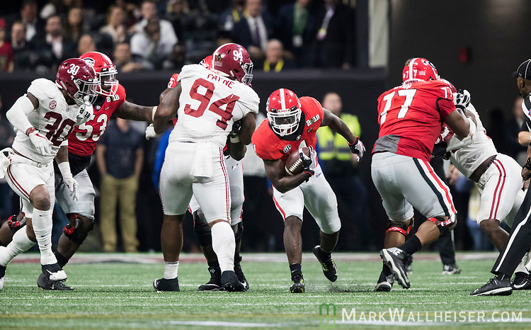 Georgia Bulldogs running back Sony Michel (1) runs through a hole in the Alabama defense in the first half of the NCAA College Football Playoff National Championship at Mercedes-Benz Stadium on January 8, 2018 in Atlanta. Photo by Mark Wallheiser/UPI