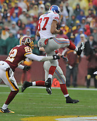 Landover, MD - November 30, 2008 -- New York Giants wide receiver Domenik Hixon (87) makes a leaping catch over Washington Redskins cornerback Carlos Rogers (22) in the first quarter at FedEx Field in Landover, Maryland on Sunday, November 30, 2008..Credit: Ron Sachs / CNP.(RESTRICTION: No New York Metro or other Newspapers within a 75 mile radius of New York City)