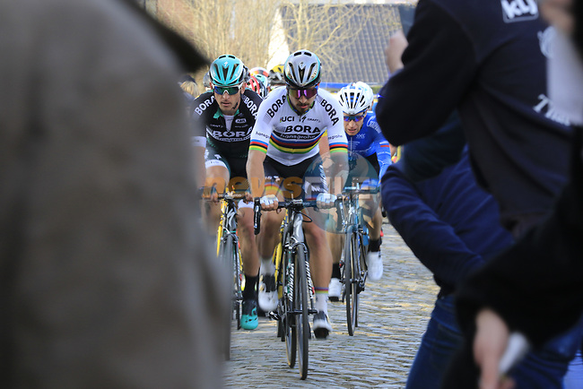 World Champion Peter Sagan (SVK) Bora-Hansgrohe climbs Oude Kwaremont after crashing during the 60th edition of the Record Bank E3 Harelbeke 2017, Flanders, Belgium. 24th March 2017.<br /> Picture: Eoin Clarke | Cyclefile<br /> <br /> <br /> All photos usage must carry mandatory copyright credit (&copy; Cyclefile | Eoin Clarke)