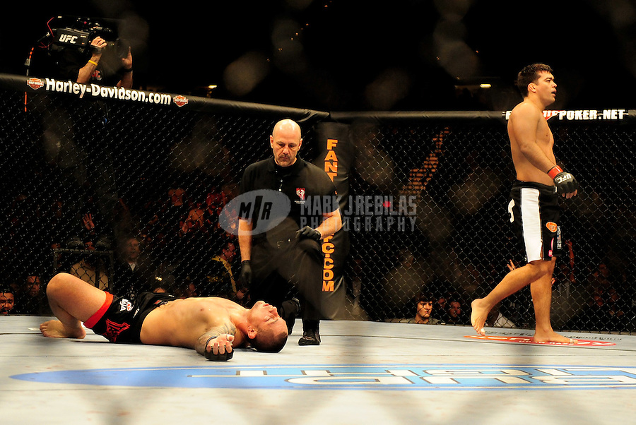 Jan. 31, 2009; Las Vegas, NV, USA; UFC fighter Lyoto Machida (right) walks away after knocking out Thiago Silva during the light heavyweight bout in UFC 94 at the MGM Grand Hotel and Casino. Mandatory Credit: Mark J. Rebilas-