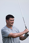 Yao Ming tees off during the World Celebrity Pro-Am 2016 Mission Hills China Golf Tournament on 22 October 2016, in Haikou, China. Photo by Victor Fraile / Power Sport Images