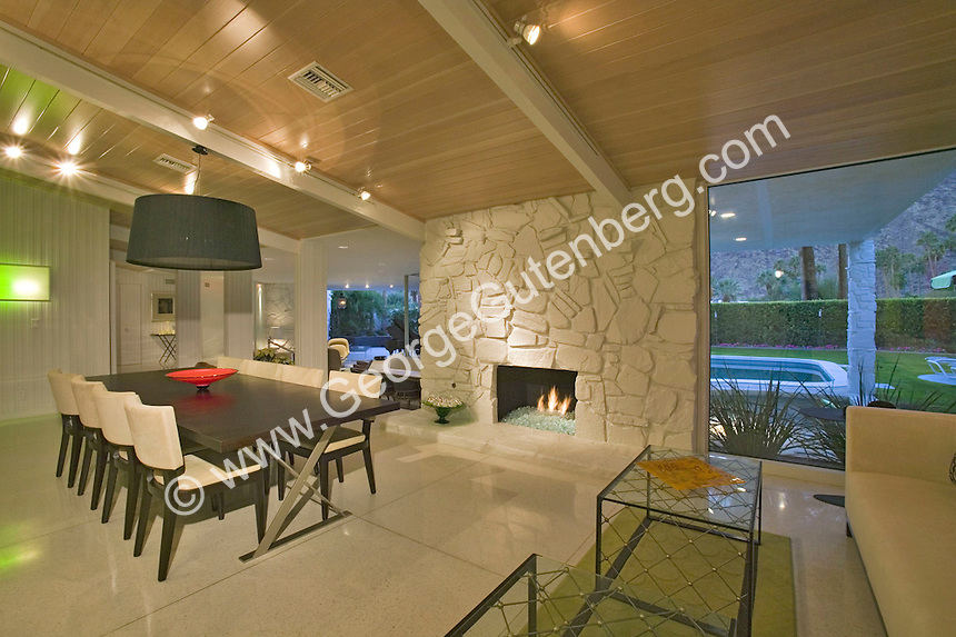 Stock photo of Palm Springs house with fireplace in dining room