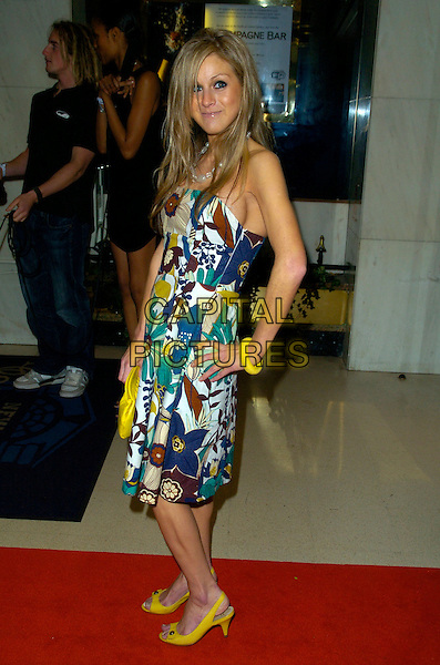 NIKKI GRAHAME.Arrivals - The Kickers Urban Music Awards 2007,.New Connaught Rooms, Great Queen Street,.London, England, Nove,ber 3rd 2007..full length big brother green blue printed dress yellow shoes bag bracelet hand on hip.CAP/CAN.©Can Nguyen/Capital Pictures