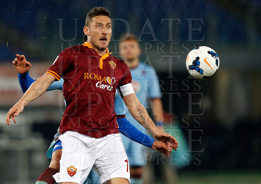 Calcio, Serie A: Roma vs Torino. Roma, stadio Olimpico, 25 marzo 2014.<br /> AS Roma forward Francesco Totti in action during the Italian Serie A football match between AS Roma and Torino at Rome's Olympic stadium, 25 March 2014.<br /> UPDATE IMAGES PRESS/Riccardo De Luca