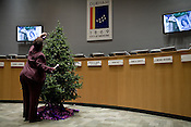 December 18, 2008. Durham, North Carolina..Members of the Durham community gathered at the city council chambers for the 8th annual Christmas tree lighting in honor of North Carolinians killed by domestic violence.. Portia Shipman, Executive Director of the Sherri Denese Jackson Foundation hangs an ornament in honor of Ms. Jackson who was killed by her ex boyfriend DeCarlo Bennett in 2007.