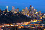 Seattle, Washington<br /> Night view of the city skyline, Elliott Bay and hillside homes of the Queen Anne neighborhood