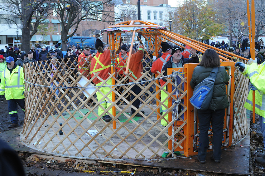 November 23, 2011, wrapping up the eviction, Toronto City workers, surrounded by police, protest supporters and media people, dismantle the library yurt, the last remaining Occupy Movement structure at St. James Park.  The Toronto Police Service, municipal works staff and protest coordinators are all winning high praise for a dignified, orderly, respectful and safe transition of the park.