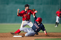 Kannapolis Intimidators shortstop Grant Massey (28) turns a double play as Nick Banks (4) of the Hagerstown Suns slides into second base at Kannapolis Intimidators Stadium on June 14, 2017 in Kannapolis, North Carolina.  The Intimidators defeated the Suns 4-1 in game one of a double-header.  (Brian Westerholt/Four Seam Images)
