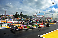 Aug. 7, 2011; Kent, WA, USA; NHRA top fuel dragster driver Terry McMillen (near lane) races alongside David Grubnic during the Northwest Nationals at Pacific Raceways. Mandatory Credit: Mark J. Rebilas-