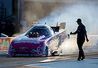 Oct 14, 2016; Ennis, TX, USA; NHRA funny car driver Courtney Force does a burnout past a crew member during qualifying for the Fall Nationals at Texas Motorplex. Mandatory Credit: Mark J. Rebilas-USA TODAY Sports