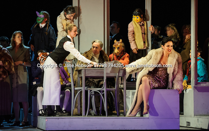 English National Opera presents, in a co-production with Dutch National Opera, Amsterdam, Puccini's LA BOHEME, at the London Coliseum. Picture shows: Simon Butteriss (Benoit), Rhian Lois (Musetta)