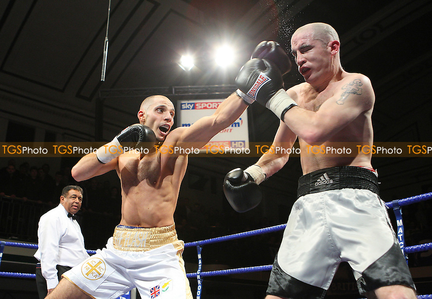 Chris Evangelou (white/gold shorts) defeats Johnny Greaves in a Light-Welterweight boxing contest at York Hall, Bethnal Green, promoted by Barry Hearn / Matchroom Sports - 12/02/10 - MANDATORY CREDIT: Gavin Ellis/TGSPHOTO - Self billing applies where appropriate - Tel: 0845 094 6026