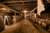 The historic Wiederkehr wine cellar made of native stone, where the award-winning Wiederkehr wines are aged with oak aging casks.
