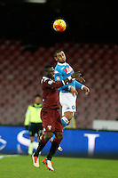 Afriyie Acquah of Torino and Napoli's Faouzi Ghoulam jump for the ball during the  italian serie a soccer match,between SSC Napoli and Torino      at  the San  Paolo   stadium in Naples  Italy , January 07, 2016